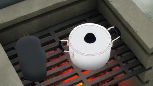 飯ごうと鍋に火を入れる